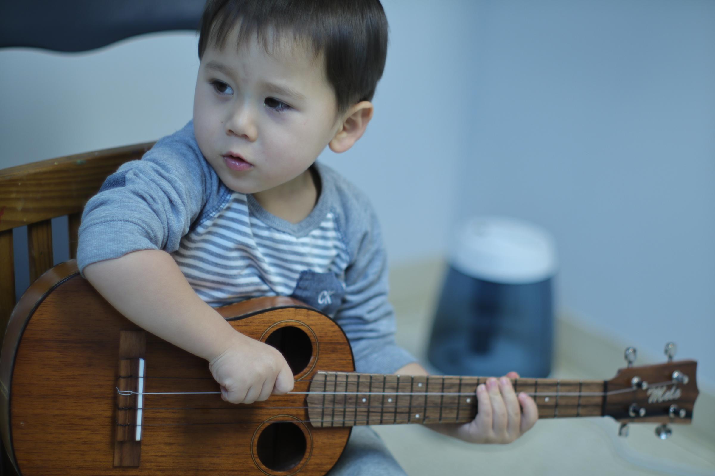 Kai plays ukulele